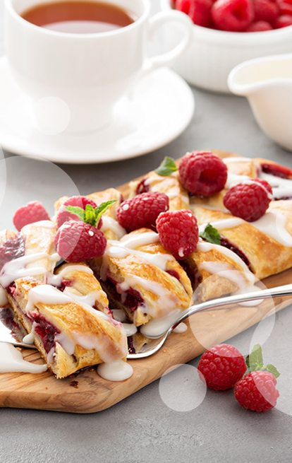 danish treat with with filling and raspberries