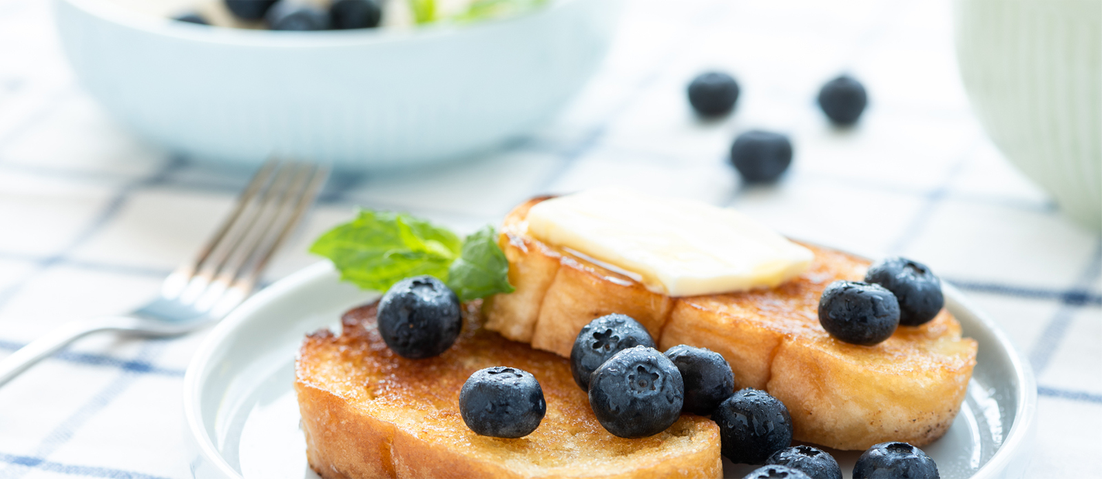plate of toast with butter and blueberries