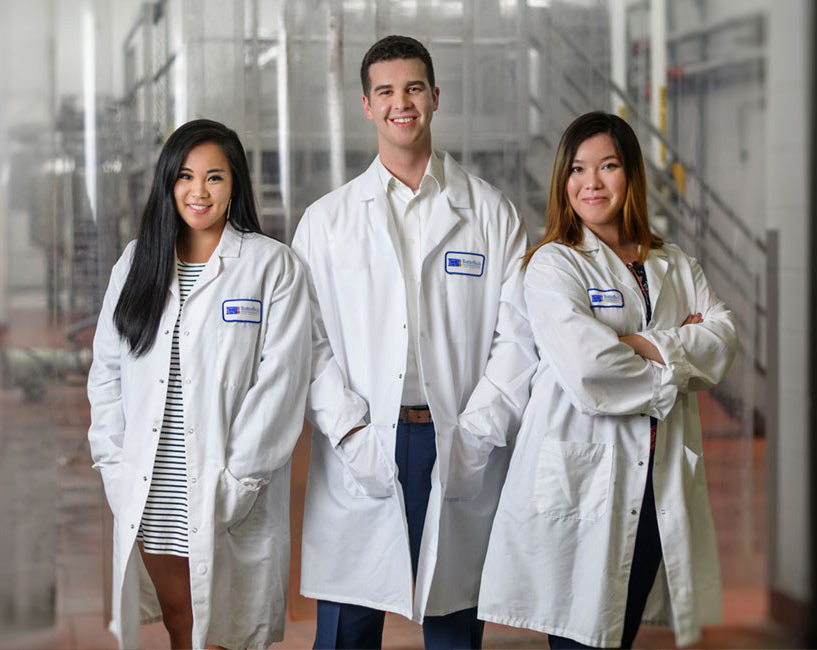 three people with lab coats