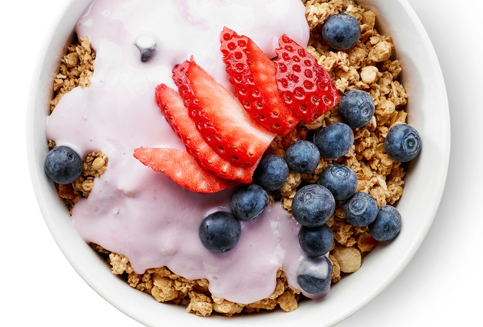bowl of granola with yogurt and berries